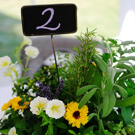 Wedding Reception Centerpieces Use Mini Chalkboards as Table Numbers