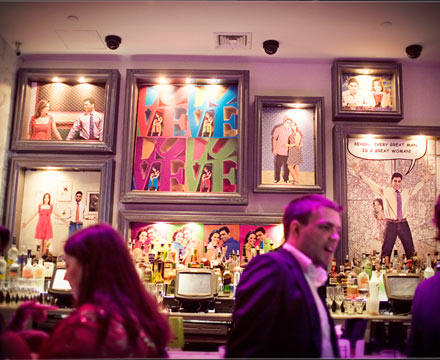 Wedding Reception Idea Decorate the Bar With Engagement Photo Art