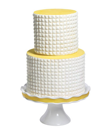 I 39m OBsessed with this twotiered yellow and white cake covered with graphic