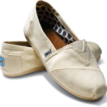 pair of TOMS shoes, a new pair of shoes is given to a child in need